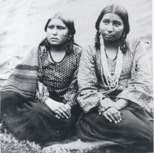 "These two Dakota girls are identified only as ""Little Crow's Daughters"" in this photo which was taken at the Fort Snelling camp in 1862. It is likely that these teen-aged girls were among Jane's students at Kaposia."
